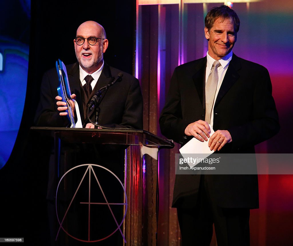Production team member of the Star Trek Franchise Alec Bernstein (L) and actor <a gi-track='captionPersonalityLinkClicked' href=/galleries/search?phrase=Scott+Bakula&family=editorial&specificpeople=217589 ng-click='$event.stopPropagation()'>Scott Bakula</a> speak on behalf of Herman Zimmerman who received the Lifetime Achievement Award at the 17th Annual Art Directors Guild Awards, held at The Beverly Hilton Hotel on February 2, 2013 in Beverly Hills, California.