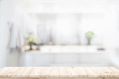 Wood Table Top And Blurred bathroom Interior Background. For product display montage.