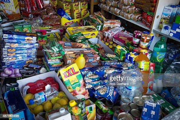 Products for sale at a shop in a make shift camp near the port of Calais on August 2 2015 in Calais France Hundreds of migrants are continuing to...