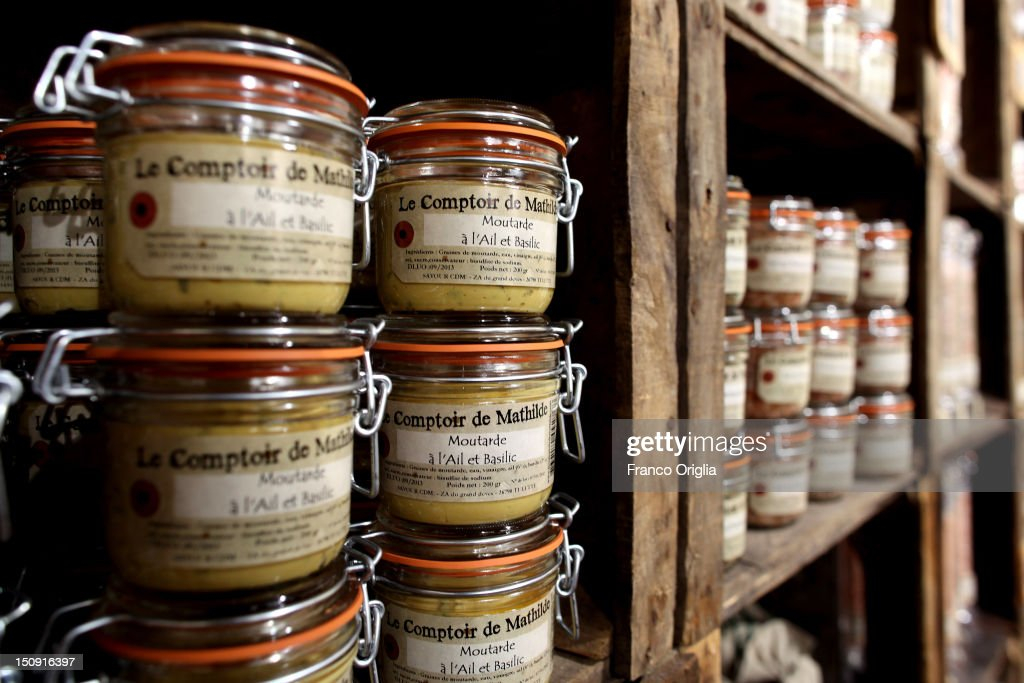 Products of the French gastronomy are shown in a food store on August 11, 2012 in Arles, France. Arles is a city in the south of France in the Mouths of the Rhone. The city has a long history, and was of considerable importance in the Roman province of Gallia. The Roman Monuments of the city were listed as UNESCO World Heritage in 1981. The Dutch painter Vincent van Gogh lived in Arles in 1888-1889 and produced over 300 paintings and drawings during his time there.