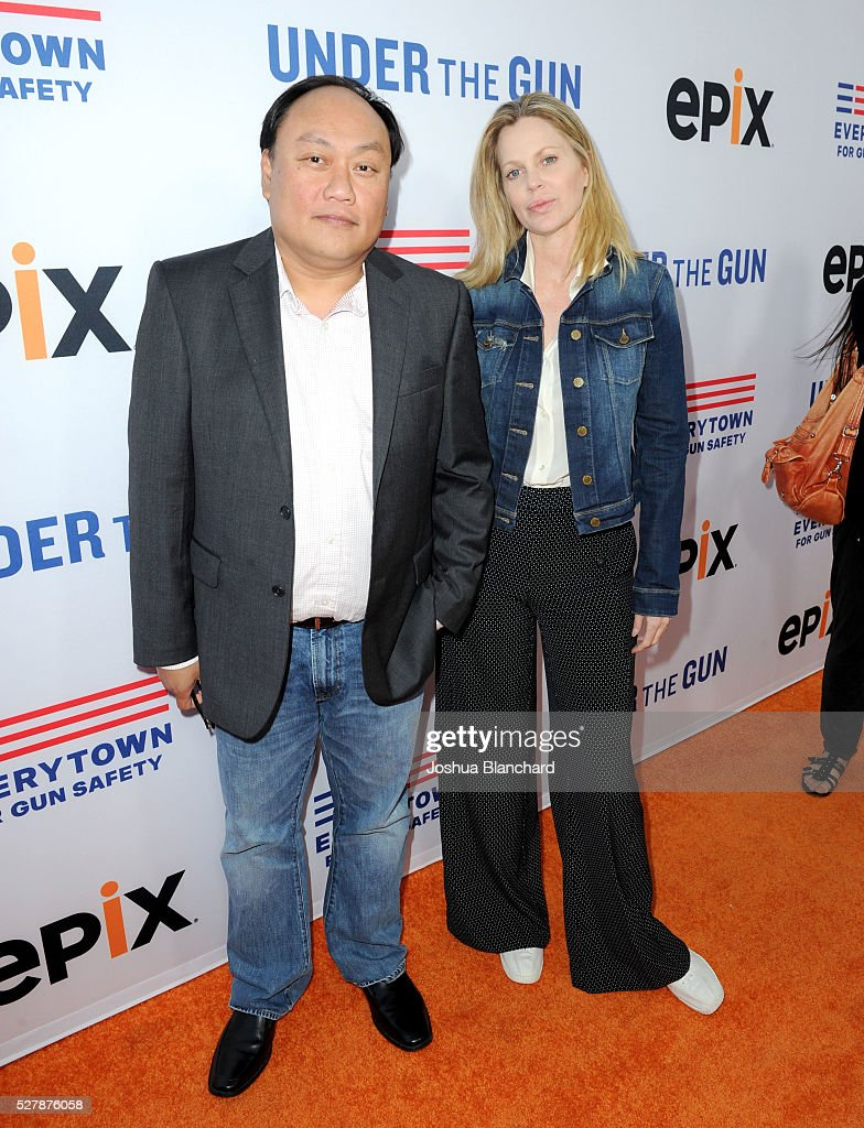 Produer Manny Oteyza and actress Kristin Bauer Van Straten attend the 'Under The Gun' LA premiere featuring Katie Couric and Stephanie Soechtig at...
