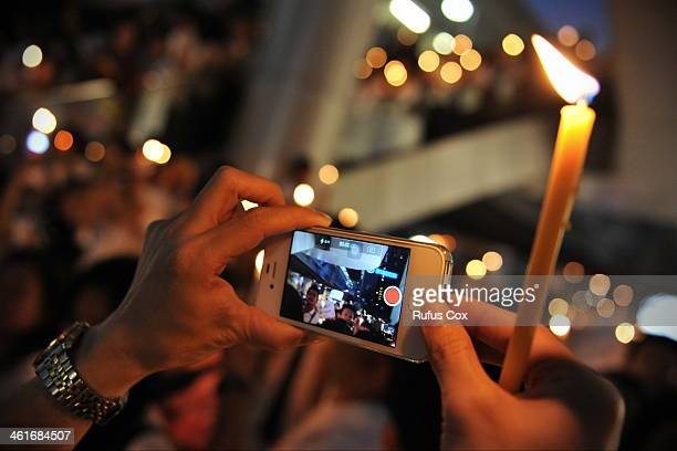 A proelection activist uses a smartphone to video a city centre rally on January 10 2014 in Bangkok Thailand Over a thousand proelection activists...