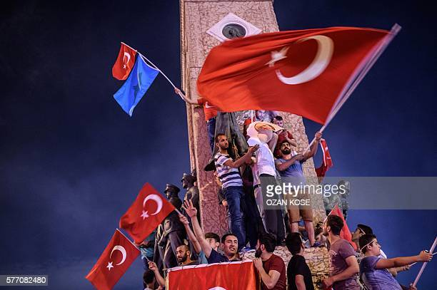 TOPSHOT ProErdogan supporters hold an effigy of USbased preacher Fethullah Gulen hunged by a noose during a rally at Taksim square in Istanbul on...