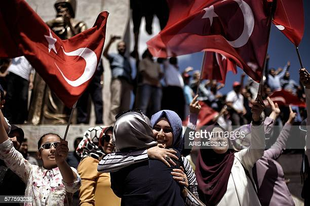 TOPSHOT ProErdogan supporters react during a protest at the Sarchane park in Istanbul on July 19 2016 The Turkish army said on July 19 that the vast...