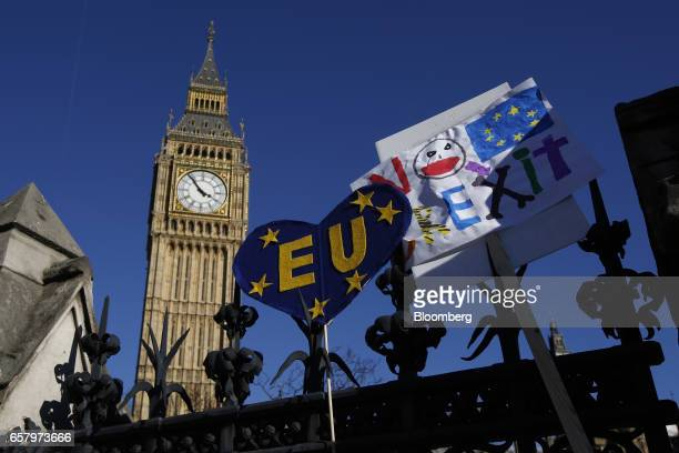 ProEU slogans and banners rest on the perimeter fence of the Houses of Parliament in front of Elizabeth Tower commonly refereed to as Big Ben during...