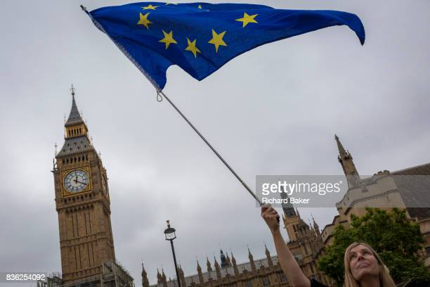 ProEurope protesters display the EU flag in front of Parliament after the last chimes of Big Ben were controversially silenced by the repair project...