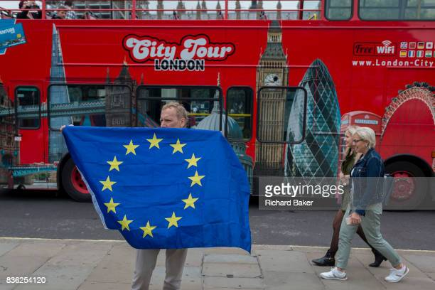 ProEurope protesters display the EU flag in front of Parliament and a passing tour bus after the last chimes of Big Ben were controversially silenced...