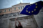 A proEuropean Union protester waves an EU flag during a demonstration in front of the parliament in Athens on June 30 2015 2015 Thousands of people...