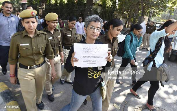 JNU prof Nivedita Menon hold Playcard against ABVP During the citizens protest march for Justice and Save Delhi University end to Gundagardi Mandi...