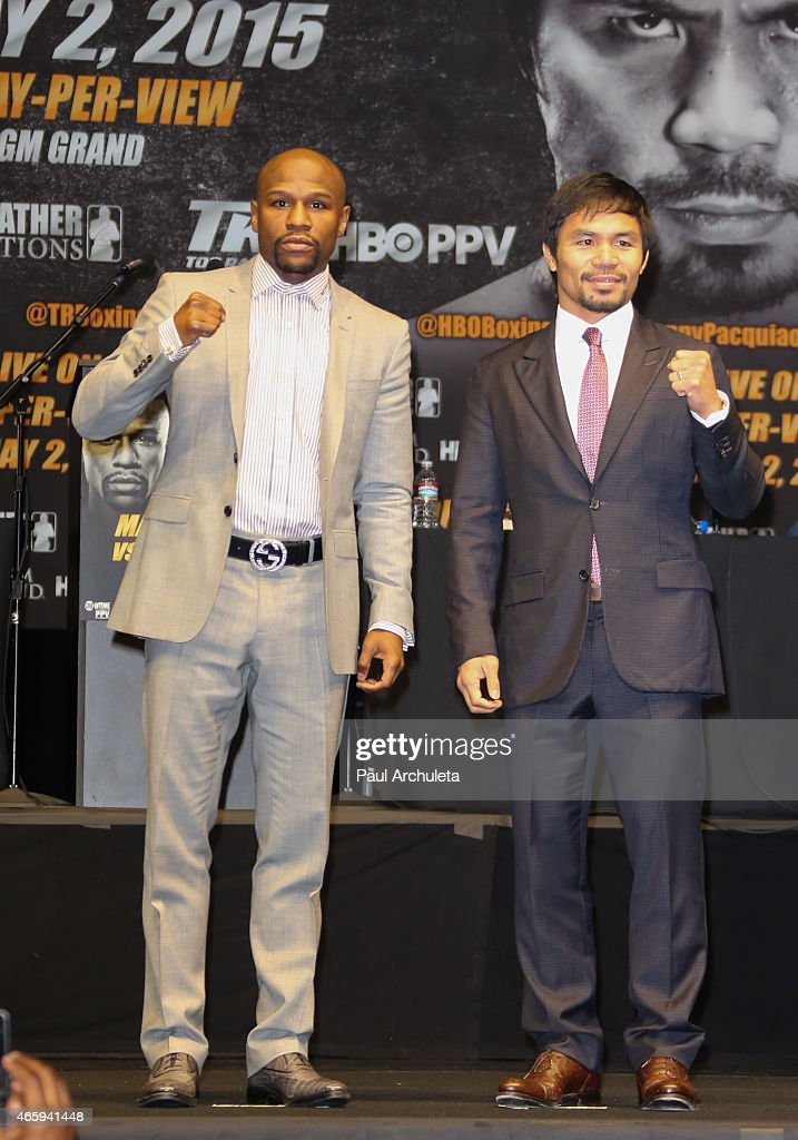 Profesional Boxers Floyd Mayweather and <a gi-track='captionPersonalityLinkClicked' href=/galleries/search?phrase=Manny+Pacquiao&family=editorial&specificpeople=3855506 ng-click='$event.stopPropagation()'>Manny Pacquiao</a> attend the press conference to announce upcoming fight with Floyd Mayweather and <a gi-track='captionPersonalityLinkClicked' href=/galleries/search?phrase=Manny+Pacquiao&family=editorial&specificpeople=3855506 ng-click='$event.stopPropagation()'>Manny Pacquiao</a> at The Nokia Theatre L.A. Live on March 11, 2015 in Los Angeles, California.