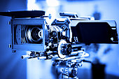 Professional 4k production video camera in studio. Shallow DOF, selective focus. Toned image.