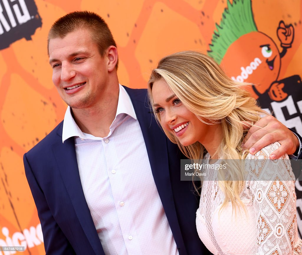 Professional American Football player Rob Gronkowski and girlfriend Camille Kostek attend the Nickelodeon Kids' Choice Sports Awards at UCLA's Pauley Pavilion on July 14, 2016 in Westwood, California.