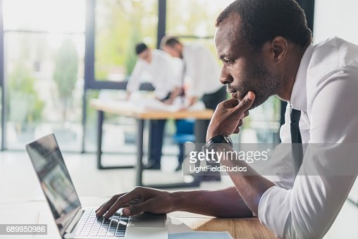 professional architects in formal wear working with laptop at modern office, businessmen group : Stock Photo