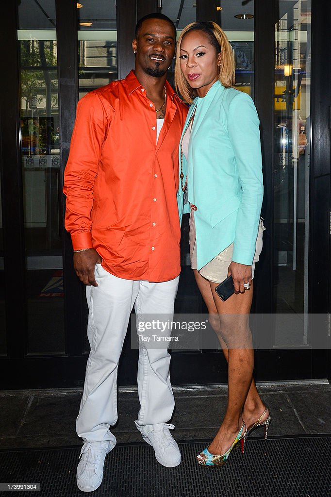 Professional atheletes Aaron Ross (L) and Sanya Richards-Ross enter the 'Good Day New York' taping at the Fox 5 Studios on July 18, 2013 in New York City.