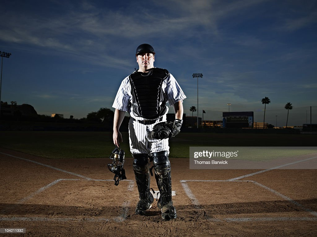 Professional baseball catcher at home plate : Stock Photo