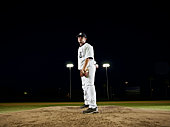 Professional baseball pitcher preparing to pitch