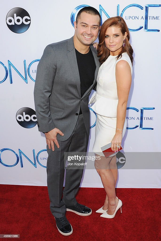 Professional baseball player Nick Swisher and wife actress JoAnna Garcia Swisher arrive at ABC's 'Once Upon A Time' Season 4 Red Carpet Premiere at...