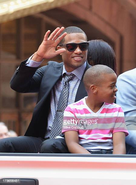 Professional baseball player Robinson Cano waves to fans as he passes by during the MLB AllStar Game Red Carpet Show on July 16 2013 in New York City