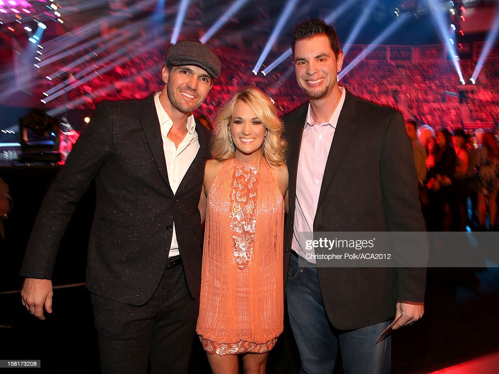 Professional Baseball players Barry Zito (L) and Brandon Belt (R) and singer Carrie Underwood (C) attend the 2012 American Country Awards at the Mandalay Bay Events Center on December 10, 2012 in Las Vegas, Nevada.