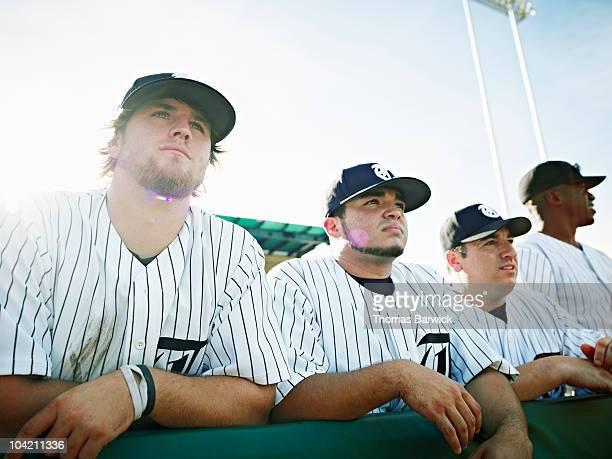 Professional baseball players watching game