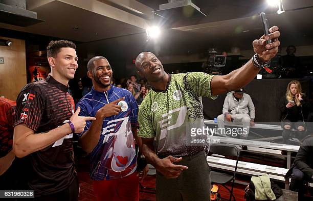 Professional basketbal players Austin Rivers Chris Paul and former football player Terrell Owens attend the State Farm Chris Paul PBA Celebrity...