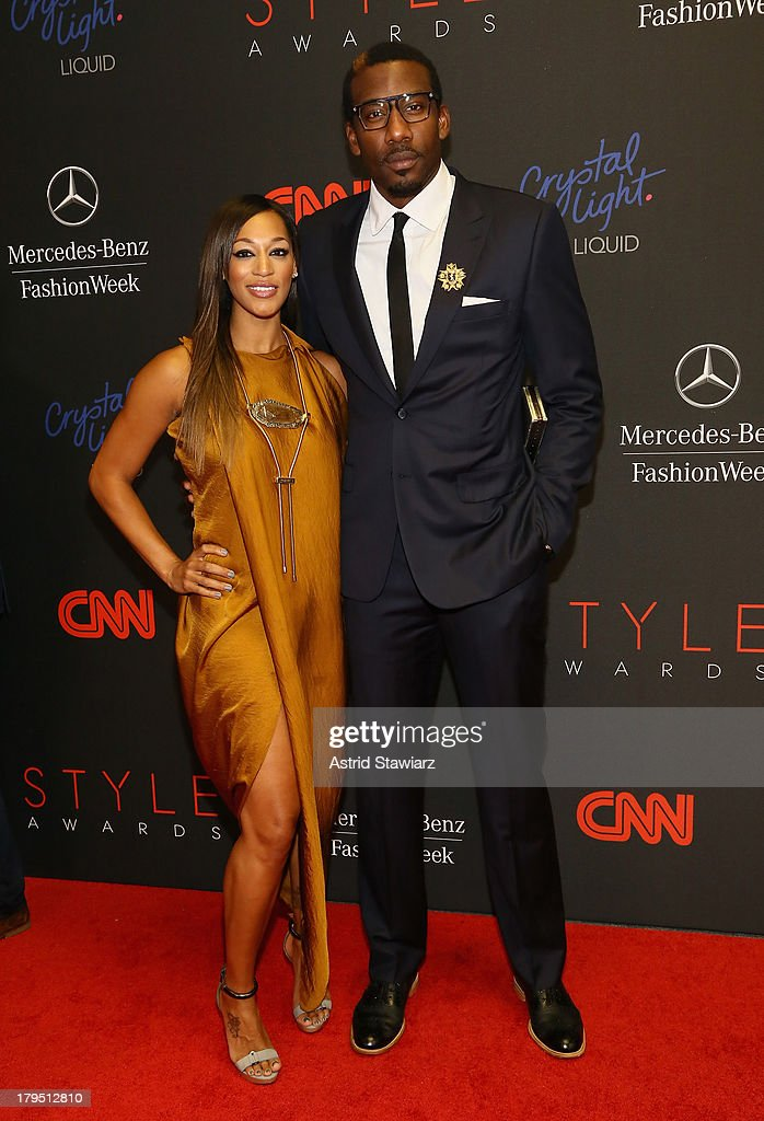 Professional Basketball Player <a gi-track='captionPersonalityLinkClicked' href=/galleries/search?phrase=Amar%27e+Stoudemire&family=editorial&specificpeople=201492 ng-click='$event.stopPropagation()'>Amar'e Stoudemire</a> (R) and Alexis Welch attend the 10th annual Style Awards during Mercedes Benz Fashion Week Spring 2014 at Lincoln Center on September 4, 2013 in New York City.