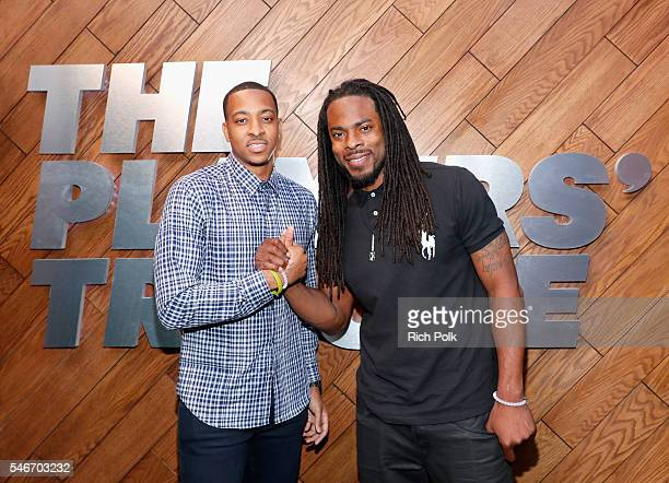 Professional basketball player C J McCollum and professional football player Richard Sherman attend The Players' Tribune Summer Party at No Vacancy...