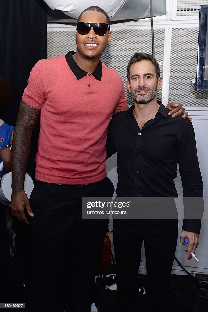Professional basketball player Carmelo Anthony and designer Marc Jacobs pose backstage at the Marc Jacobs Spring 2014 fashion show at The New York State Armory, 68 Lexington on September 12, 2013 in New York City.