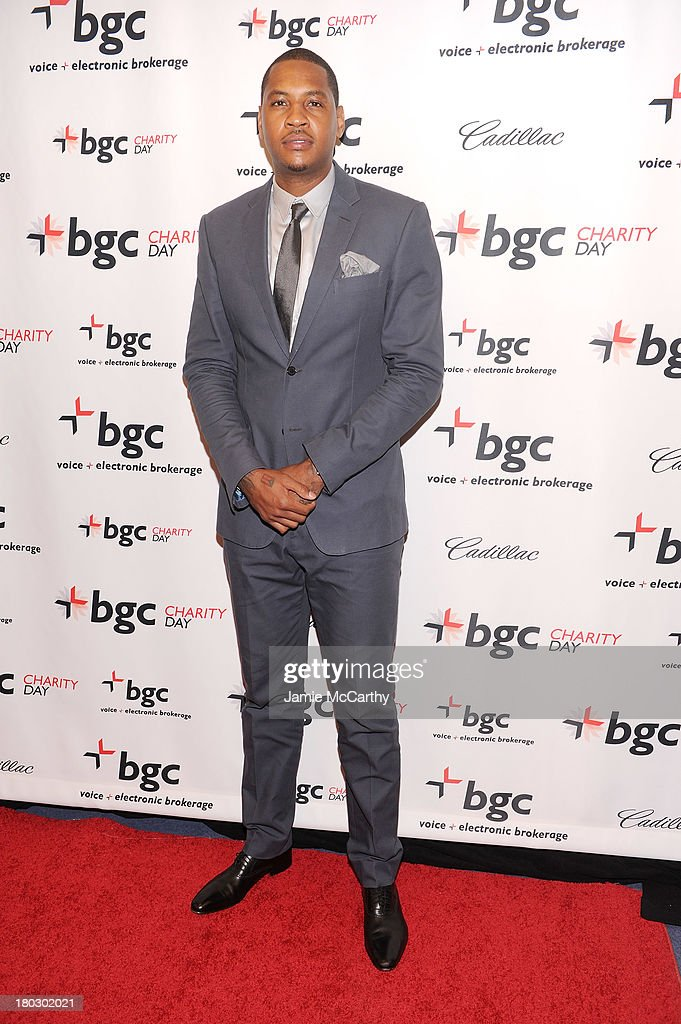 Professional basketball player Carmelo Anthony attends the annual charity day hosted by Cantor Fitzgerald and BGC at the BGC office on September 11, 2013 in New York City.
