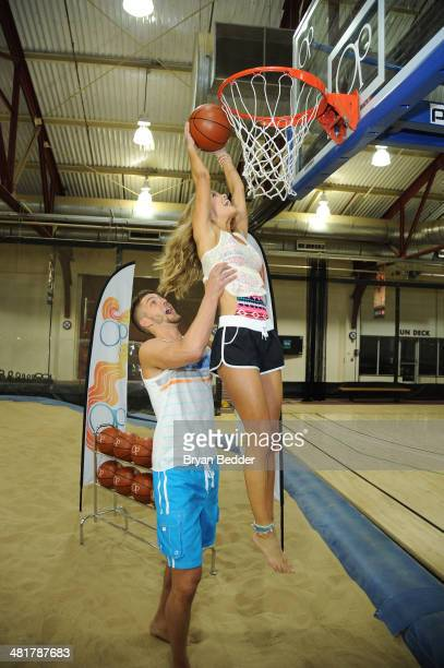 Professional basketball player Chandler Parsons and model Nina Agdal play basketball as Op Nina Agdal Chandler Parsons kick off Spring on March 31...