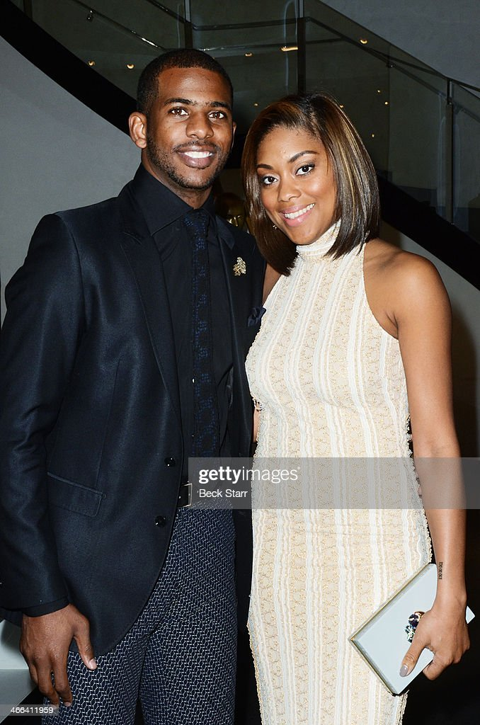 Professional basketball player <a gi-track='captionPersonalityLinkClicked' href=/galleries/search?phrase=Chris+Paul&family=editorial&specificpeople=212762 ng-click='$event.stopPropagation()'>Chris Paul</a> and his wife Jada attends Matt Barnes Foundation Athletes Vs. Cancer event at Versace Boutique on January 31, 2014 in Beverly Hills, California.