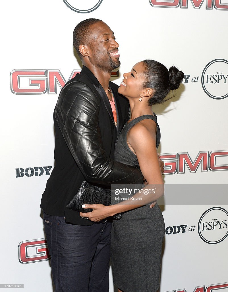 Professional basketball player Dwyane Wade (L) and actress Gabrielle Union attend ESPN The Magazine 5th annual 'Body Issue' party at Lure on July 16, 2013 in Hollywood, California.