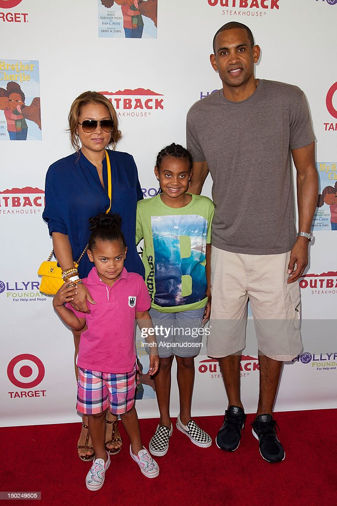 Professional basketball player <a gi-track='captionPersonalityLinkClicked' href=/galleries/search?phrase=Grant+Hill+-+Basketball+Player&family=editorial&specificpeople=201658 ng-click='$event.stopPropagation()'>Grant Hill</a> (R) and family attend the 3rd Annual My Brother Charlie Family Fun Festival at Culver Studios on August 12, 2012 in Culver City, California.