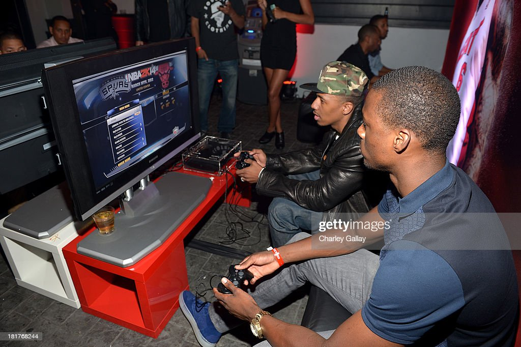 Professional basketball player Harrison Barnes (L) and and TV personality Nick Cannon attend the NBA 2K14 premiere party at Greystone Manor on September 24, 2013 in West Hollywood, California.
