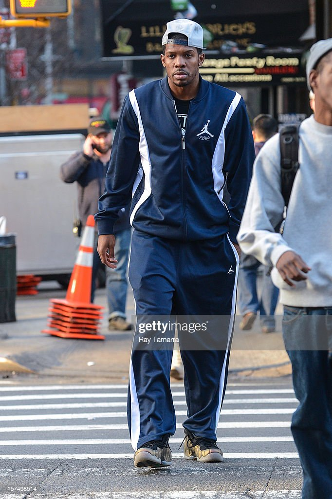Professional basketball player <a gi-track='captionPersonalityLinkClicked' href=/galleries/search?phrase=Joe+Johnson+-+Basketball+Player&family=editorial&specificpeople=201652 ng-click='$event.stopPropagation()'>Joe Johnson</a> walks in lower Manhattan on December 3, 2012 in New York City.