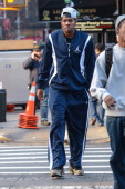 Professional basketball player Joe Johnson walks in lower Manhattan on December 3 2012 in New York City