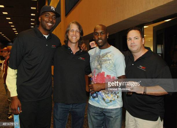 Professional basketball player John Salley Craig Thole professional basketball player Gary Payton and guest attend the 2008 World Championship of...
