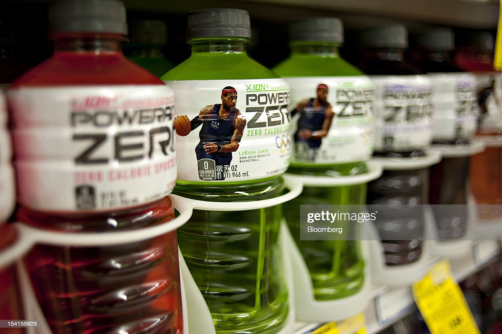 Professional basketball player <a gi-track='captionPersonalityLinkClicked' href=/galleries/search?phrase=LeBron+James&family=editorial&specificpeople=201474 ng-click='$event.stopPropagation()'>LeBron James</a> appears on a bottle of Coca-Cola Co.'s Powerade sports drink displayed in a supermarket in Princeton, Illinois, U.S., on Friday, Oct. 12, 2012. Coca-Cola Co. is scheduled to release earnings data on Oct. 16. Photographer: Daniel Acker/Bloomberg via Getty Images