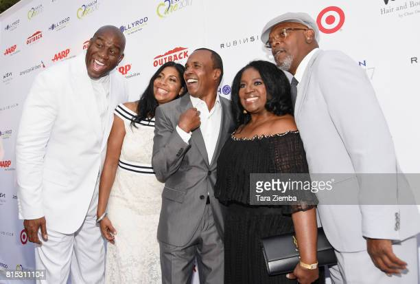 Professional basketball player Magic Johnson Cookie Johnson professional boxer Sugar Ray Leonard LaTanya Richardson and actor Samuel L Jackson attend...