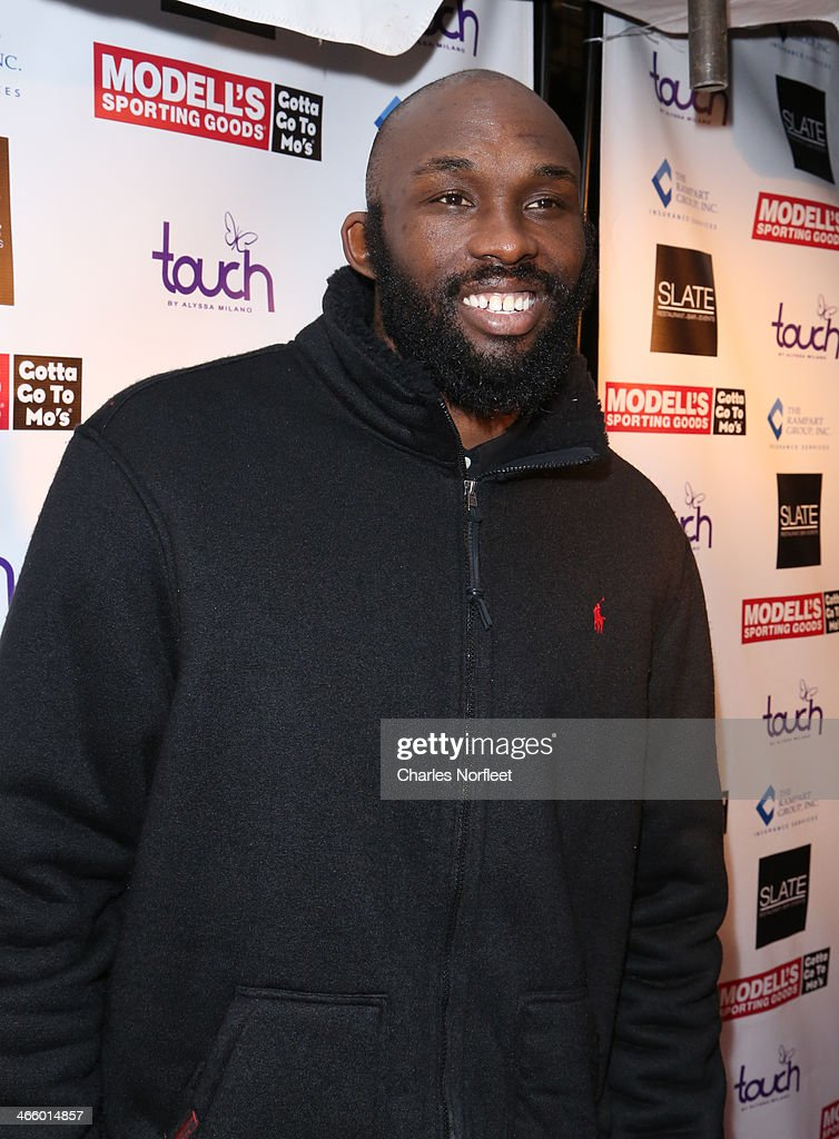 Professional basketball player <a gi-track='captionPersonalityLinkClicked' href=/galleries/search?phrase=Reggie+Evans&family=editorial&specificpeople=202254 ng-click='$event.stopPropagation()'>Reggie Evans</a> attends Modell's Super Bowl Kickoff Party & Touch By Alyssa Milano Fashion Show at Slate on January 30, 2014 in New York City.