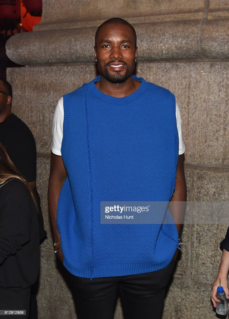 Professional Basketball Player Serge Ibaka attends the Raf Simons - Front Row/Backstage at