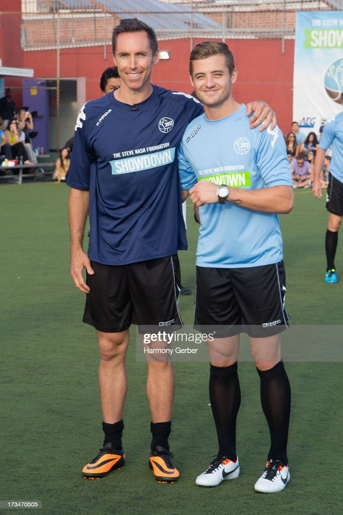 Professional basketball player Steve Nash and professional soccer player Robbie Rogers play soccer at the Salvation Army Red Shield Youth & Community Center on July 14, 2013 in Los Angeles, California.