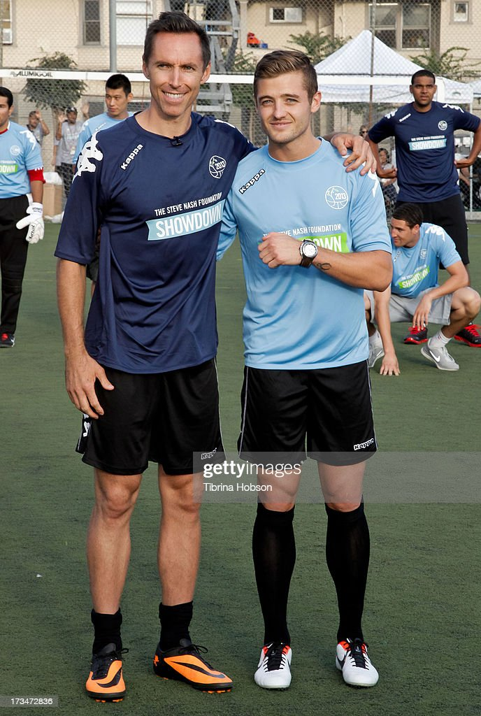 Professional basketball player Steve Nash and professional soccer player Robbie Rogers attend the Steve Nash Foundation Showdown at The Salvation Army Red Shield Youth & Community Center on July 14, 2013 in Los Angeles, California.
