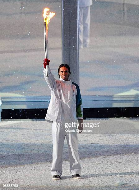 Professional basketball player Steve Nash carries the Olympic torch during the Opening Ceremony of the 2010 Vancouver Winter Olympics at BC Place on...