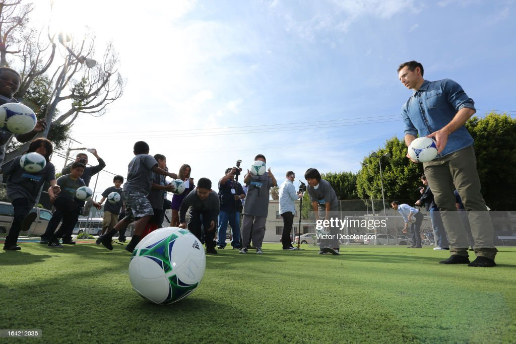 Professional basketball player Steve Nash of the Los Angeles Lakers (R) looks on as children from The Salvation Army Red Shield Youth & Community Center practice a soccer drill after Nash announced his charity soccer events at The Salvation Army Red Shield Youth & Community Center on March 20, 2013 in Los Angeles, California.