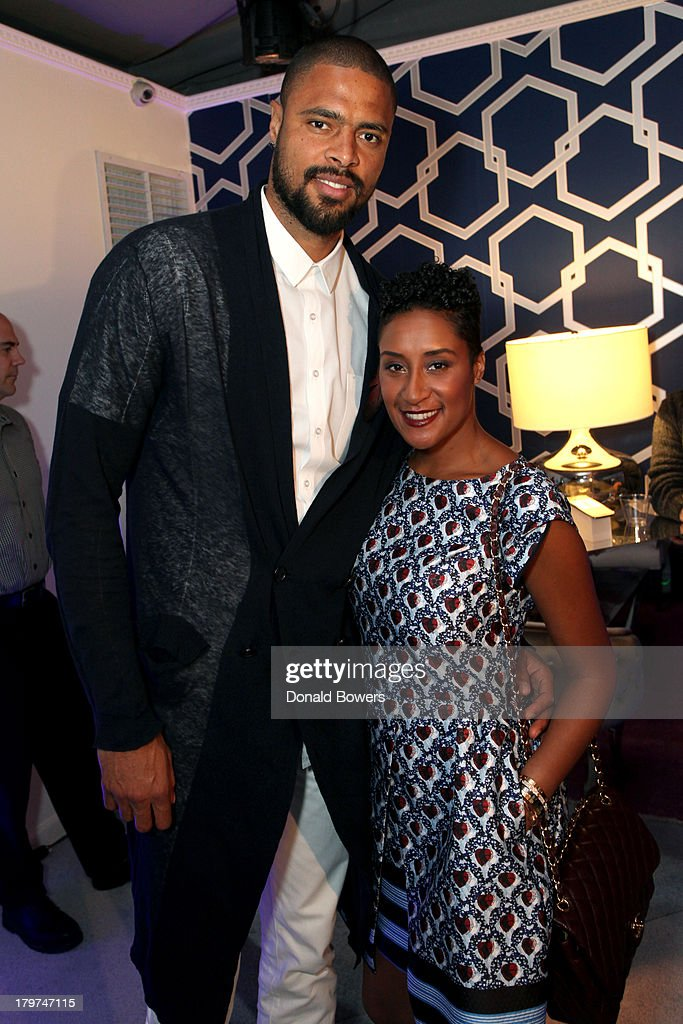 Professional basketball player <a gi-track='captionPersonalityLinkClicked' href=/galleries/search?phrase=Tyson+Chandler&family=editorial&specificpeople=202061 ng-click='$event.stopPropagation()'>Tyson Chandler</a> (L) and Kimberly Chandler attend the Samsung Galaxy Blue Room at Mercedes-Benz Fashion Week Spring 2014 Collections at Lincoln Center on September 6, 2013 in New York City.