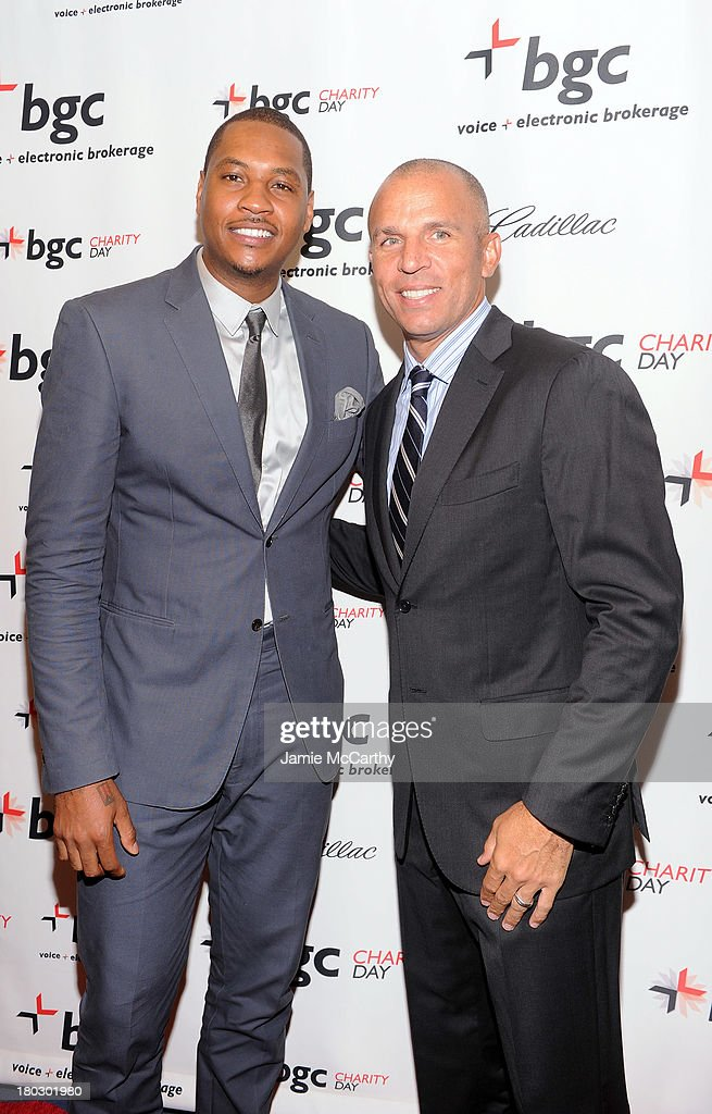 Professional basketball players Carmelo Anthony (L) and Jason Kidd attend the annual charity day hosted by Cantor Fitzgerald and BGC at the BGC office on September 11, 2013 in New York City.