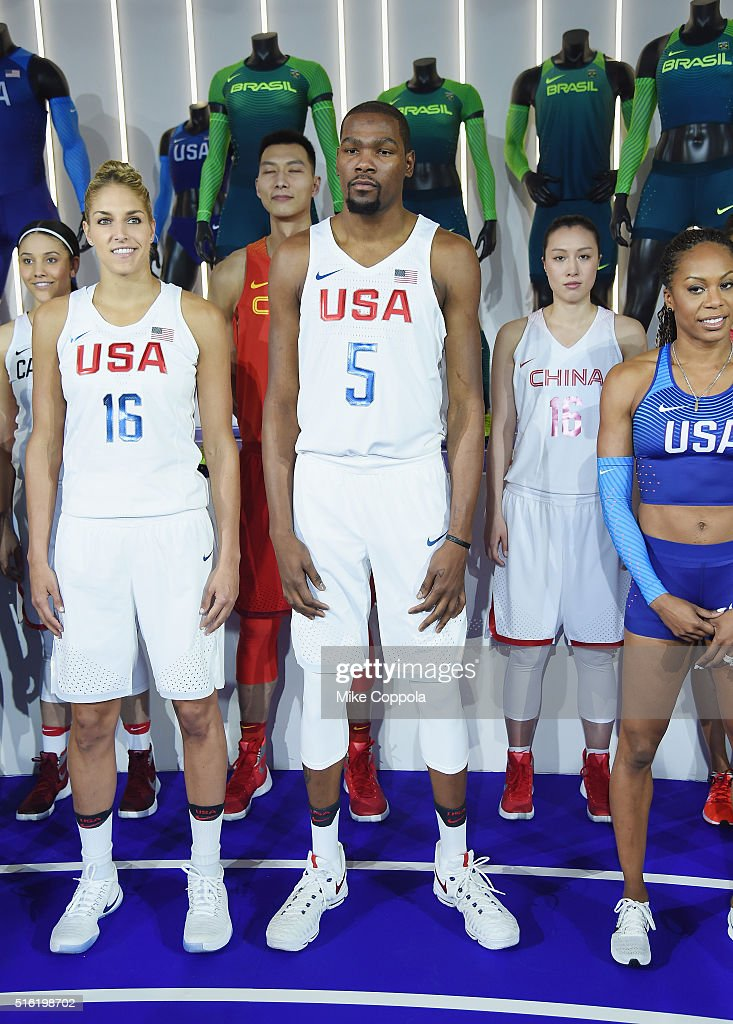 Professional basketball players <a gi-track='captionPersonalityLinkClicked' href=/galleries/search?phrase=Elena+Delle+Donne&family=editorial&specificpeople=5042380 ng-click='$event.stopPropagation()'>Elena Delle Donne</a>, <a gi-track='captionPersonalityLinkClicked' href=/galleries/search?phrase=Kevin+Durant&family=editorial&specificpeople=3847329 ng-click='$event.stopPropagation()'>Kevin Durant</a>, and <a gi-track='captionPersonalityLinkClicked' href=/galleries/search?phrase=Sanya+Richards&family=editorial&specificpeople=239062 ng-click='$event.stopPropagation()'>Sanya Richards</a>-Ross show off the 2016 Olympics Uniforms For USA And International Federations Debut at Skylight at Moynihan Station on March 17, 2016 in New York City.