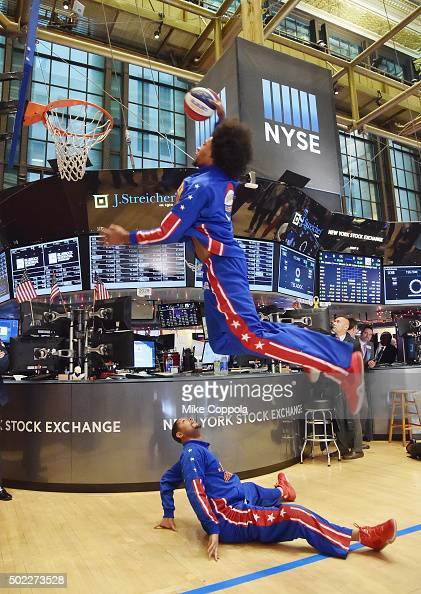Professional basketball players Moose Weekes dunks a basketball over Handles Franklin of the Harlem Globetrotters Celebrate 90th Year At The New York...
