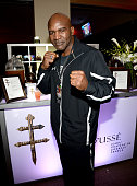 Professional boxer Evander Holyfield attends Roc Nation Sports Golden Boy Promotions Miguel Cotto Promotions And Canelo Promotions Present Miguel...